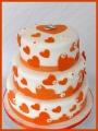 Hochzeitstorte Herzen weiß orange